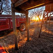Lens flare at sunset on a rural Kansas farm.