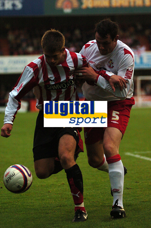 Photo: Tony Oudot.<br /> Brentford v Lincoln City. Coca Cola League 2. 27/10/2007.<br /> Charlie Ide of Brentford is challenged by Lee Beevers of Lincoln
