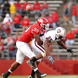 Oct 10, 2009; Piscataway, NJ, USA; Rutgers defensive end Jonathan Freeny (99) and the ball reach Texas Southern running back Martin Gilbert (25) at the same time during second half NCAA college football action in Rutgers' 42-0 victory over Texas Southern at Rutgers Stadium.