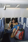 teenager Traveller resting during an El Al flight on a Boeing 767, July 2006, Model released