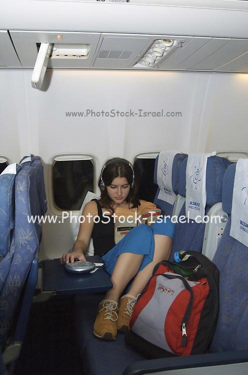 teenager Traveller resting during an El Al flight on a Boeing 767, July 2006, Model released