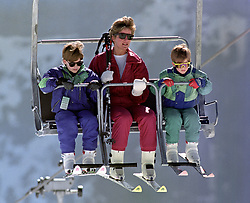 The Princess of Wales rides a chair lift up the Kriegerhorn with her sons Prince William, left, and Prince Harry, in Lech, Austria.