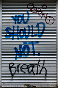 "Graffiti ""You Should Not Breath"" sprayed on roller blinds in London, UK"