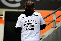 A Leicester City fan wears a shirt that reads 'Khun Vichai You Will Be Forever In Our Hearts' during the Premier League match at the Cardiff City Stadium, Cardiff.