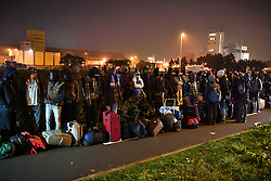 © Licensed to London News Pictures. 24/10/2016. Calais, France. Evacuation and demolition begins at the migrant camp in Calais, known as the 'Jungle'. French authorities have given an eviction order to thousands of refugees and migrants living at the makeshift living area of the French coast. Photo credit: Ben Cawthra/LNP