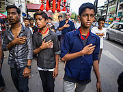 03 NOVEMBER 2014 - YANGON, MYANMAR:  Shia Muslims in Yangon walk through the streets beating their chests during the celebration of Ashura. Shia Muslims in Yangon started the celebration of Ashura Monday. Ashura commemorates the death of Hussein ibn Ali, the grandson of the Prophet Muhammed, in the 7th century. Hussein ibn Ali is considered by Shia Muslims to be the third Imam and the rightful successor of Muhammed. He was killed at the Battle of Karbala in 610 CE on the 10th day of Muharram, the first month of the Islamic calendar. According to Myanmar government statistics, only about 4% of Myanmar is Muslim. Many Muslims have fled Myanmar in recent years because of violence directed against Burmese Muslims by Buddhist nationalists.   PHOTO BY JACK KURTZ