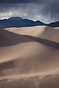 Mount Cleveland rises over the dune field of Great Sand Dunes National Park, Colorado.