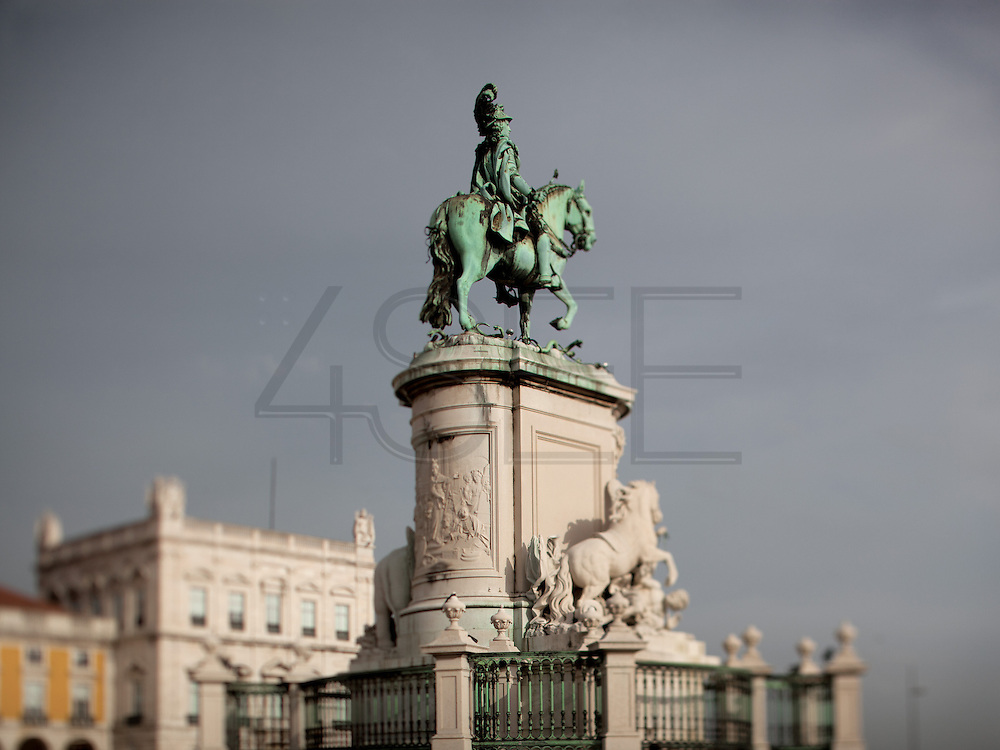 The statue of D. José I, the king that reconstructed Lisbon after the 1755 earthquake. From Praça do Comércio he stays facing the river Tejo (Tagus), , where once the portuguese left to India.This photograph is part of a body of work about Lisbon, feelings, affections and loneliness. Is about a city depressed by the crisis, but even so, tolerant and cosmopolitan. This part of Lisbon,with his deep character, where local people meets foreigners and alternative ways of life mixes with shamefaced poverty, is sublime by its peculiar light.
