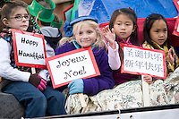 Children celebrating the holidays from around the world on the Lakeland School float during Sunday's Holiday Parade through downtown Laconia.  (Karen Bobotas/for the Laconia Daily Sun)