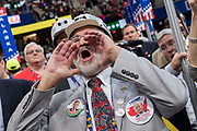 Coal supporters wear miners hats with pro-Trump slogans during an address on coal during the second day of the Republican National Convention via live video link July 19, 2016 in Cleveland, Ohio. Earlier in the day the delegates formally nominated Donald J. Trump for president.