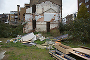 Derelict land, undoubtedly ready for development on the edge of the City of London, UK. Currently a dump of old furniture, this area is being redevloped and changing from a once quiet area into one full of apartment blocks and student accommodation.