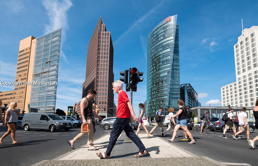 Pedestrian crossing and cityscape of Potsdamer Platz modern business and entertainment district in Berlin, Germany