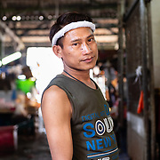 Portrait of fishmonger at Khlong Toei market, Bangkok