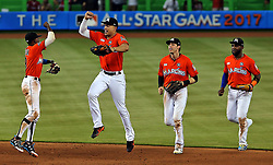 June 4, 2017 - Miami, FL, USA - Miami Marlins' Giancarlo Stanton leaps in the air in celebration with Dee Gordon as the Marlins beat the Arizona Diamondbacks on Sunday, June 4, 2017 at Marlins Park in Miami, Fla. (Credit Image: © Patrick Farrell/TNS via ZUMA Wire)