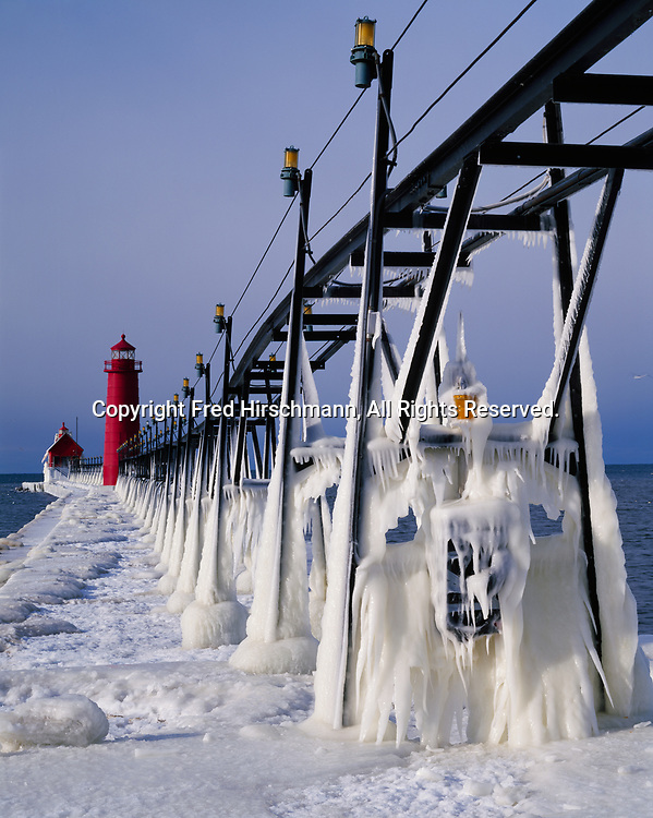 Ice-covered catwalk leading to Grand Haven Inner and South Pierhead Lighthouses, Grand River, Lake Michigan, Grand Haven State Park, Grand Haven, Michigan.