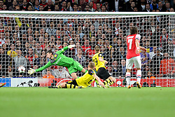 Borrusia Dortmund's Roman Weidenfeller manges to stop Arsenal's Tomas Rosicky shot on goal. - Photo mandatory by-line: Alex James/JMP - Tel: Mobile: 07966 386802 22/10/2013 - SPORT - FOOTBALL - Emirates Stadium - London - Arsenal v Borussia Dortmund - CHAMPIONS LEAGUE - GROUP F