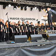 Westend Music Choir perfroms at the Feast of St George to celebrate English culture with music and English food stalls in Trafalgar Square on 20 April 2019, London, UK.