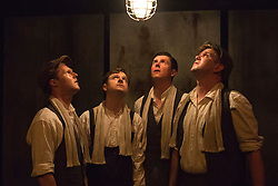 © Licensed to London News Pictures. 28/07/2015. London, UK. L-R: Paul Tinto as Phil, Salvatore D'Aquilla as Bob, James Wallwork as Arthur and Kieran Knowles as Tommy. World premiere of the play Operation Crucible at the Finborough Theatre. The play commemorates the 75th anniversary of the Sheffield Blitz and the 70th anniversary of the end of the Second World War with four men trapped in the rubble. The play by Kieran Knowles and directed by Bryony Shanahan runs at the Finborough Theatre from 28 July to 22 August 2015. With Salvatore D'Aquilla, Kieran Knowles, Paul Tinto and James Wallwork. Photo credit: Bettina Strenske/LNP