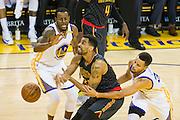 Golden State Warriors forward Andre Iguodala (9) and guard Stephen Curry (30) double team Atlanta Hawks forward Thabo Sefolosha (25) at Oracle Arena in Oakland, Calif., on November 28, 2016. (Stan Olszewski/Special to S.F. Examiner)