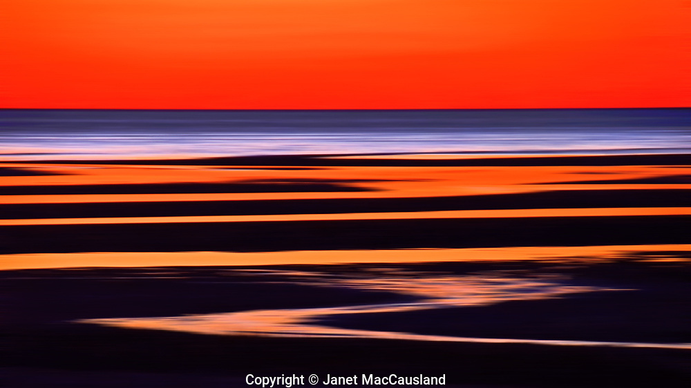 """""""Après Sunset"""" is a motion blur image made after the sun went down over Cape Cod Bay.  I often wonder why people flock to the best sunset sites and leave when the sun drops, when the best color is often soon after."""