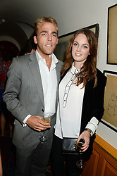 WILL WELLS and LADY VIOLET MANNERS at an exhibition of the 50 best party pictures from Tatler from the past 50 years, held at Annabel's, Berkeley Square, London on 9th September 2013.