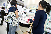 women shopping in a makeup fashion store Tokyo Japan