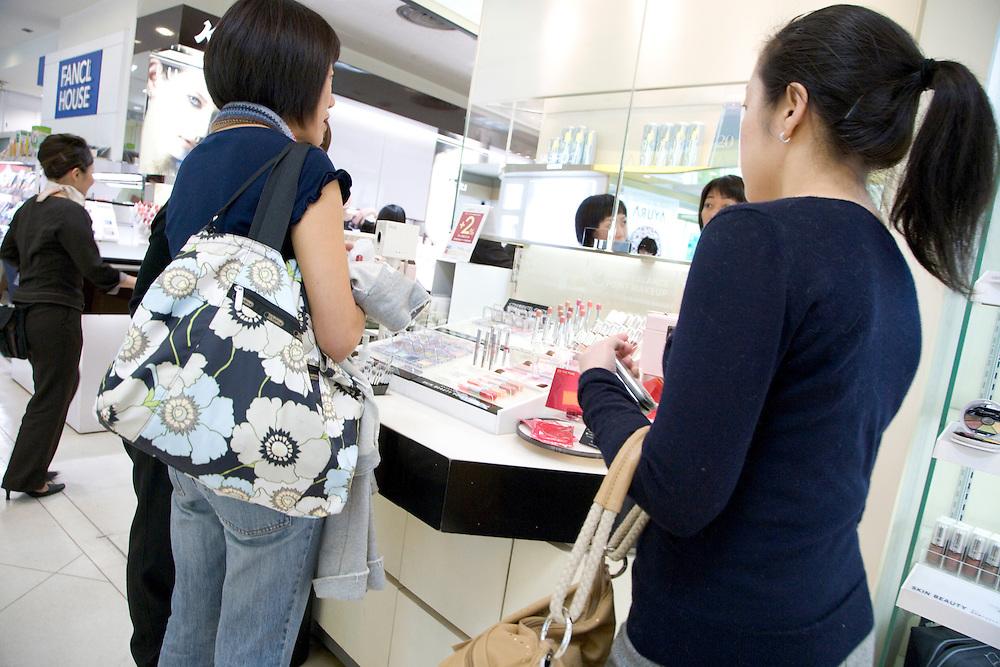women shopping in a makeup fashion store Tokyo Japan