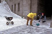 2 men shoveling driveway