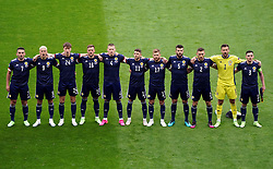 Scotland's Stephen O'Donnell, Lyndon Dykes, Jack Hendry, Grant Hanley, Liam Cooper, goalkeeper David Marshall, Ryan Christie, John McGinn, Scott McTominay, Andrew Robertson and Stuart Armstrong line up for the UEFA Euro 2020 Group D match at Hampden Park, Glasgow. Picture date: Monday June 14, 2021.