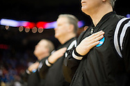 21 MAR 2015: Referees pause during the National Anthem before University of California - Los Angeles takes on the University of Alabama - Birmingham during the 2015 NCAA Men's Basketball Tournament held at the KFC Yum! Center in Louisville, KY. UCLA defeated UAB 92-75. Brett Wilhelm/NCAA Photos