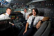 The cockpit crew of the final scheduled flight of a Northwest Airline Boeing 747-200. Client: Northwest Airlines. (Photo/John Froschauer)