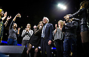 "U.S. Democratic Presidential candidate Senator Bernie Sanders (I-Vt.), center, musical artists, and supporters sing ""This Land is Your Land"" at the ""Future to Believe In"" Rally at the Kohl Center in Madison, Wisconsin April 3, 2016."