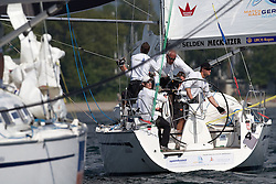 Jesper Radich of Denmark looks over his shoulder at Mathieu Richard of France during their semi-final match at Match Race Germany 2010. World Match Racing Tour. Langenargen, Germany. 23 May 2010. Photo: Gareth Cooke/Subzero Images/WMRT