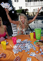 22 June 2005:  Stacia Raystone-Robitaille celebrates a good hand in poker with NHL wives in Beverly Hills during The Not so Desperate, Desperate housewives shoot on location in Los Angeles with NHL hockey players wives for Editorial Use Only!  Mandatory Credit:  Shelly Castellano.com or Price Doubles. .