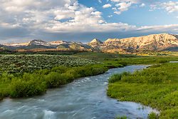 A rushing mountain stream during runoff.  The Gros Ventre Mountains beyond are one of the dozens of amazing mountain ranges of the Greater Yellowstone ecosystem