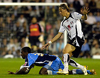 Photo: Daniel Hambury.<br />Fulham v Wycombe Wanderers. Carling Cup. 20/09/2006.<br />Fulham's Bjorn Runstrom fouls Wycombe's Anthony Grant.