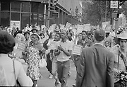 Poor People's March at Lafayette Park and on Connecticut Avenue.  People marching and carrying signs, 18 June 1968.     Photographer: Warren K  Leffler.