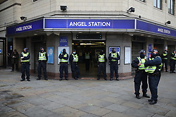 © Licensed to London News Pictures. 28/11/2020. London, UK. Police presence at Angel Station where anti-lockdown protesters are gathering ahead of planned anti-lockdown protests. Tiered restrictions will be reintroduced when the England-wide lockdown ends on 2 December. Photo credit: Rob Pinney/LNP