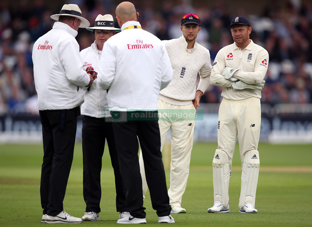 England's Joe Root and Jonny Bairstow wait as the umpires examine the ball before the start of day two of the Second Investec Test match at Trent Bridge, Nottingham.
