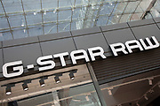 Sign for the high street clothing brand G-Star Raw in Birmingham, United Kingdom.