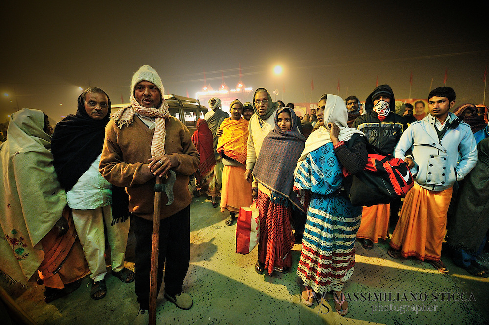 Pilgrims in Kumbh Mela, go to tents or find accommodation along the street after the Holy Bath on Mauni Amawasya day