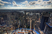 Ninety floors... and counting: The breathtaking views from One World Trade Center (and there's still 14 storeys to go)<br /> <br /> When it is completed, it will be the tallest building in Manhattan and one of incredible poignancy for New York City.<br /> One World Trade Center reached its 90th floor this week - with just 14 more floors to go until the top. The structure can now be seen from all five boroughs of the city. <br /> Stunning pictures showed how the area has been reborn since the 9/11 attacks more than a decade ago where almost 3,000 people lost their lives in the worst ever terrorist attack on American soil.<br /> One World Trade Center is on track to be completed by 2013 with construction workers approximately finishing a floor a week in downtown Manhattan.<br /> Electrical contractors at the tower agreed to give it a festive feel and wrapped the exterior lamps they use with coloured cellophane in time for Christmas. <br /> <br /> Developments can be followed on One World Trade Center's Twitter feed @WTCProgress. Glass now covers up to the 65th floor and concrete has been added up to the 82nd level. There will be 104 floors in the completed building, making it the tallest in Manhattan.<br /> The site will be a place of reflection and contemplation for many and The National September 11 Memorial And Museum, designed by the winning team of Michael Arad and Peter Walker, was opened for the 10th anniversary of the terrorist attacks.<br /> One World Trade Center, designed by renowned architect David Childs, standing in the north-west corner, is the site's centrepiece. The first cornerstone was laid down on July 4 2004 and as the building rose it was known as Freedom Tower.<br /> <br /> It stands in the footsteps of the original twin towers among a small forest of oak trees in an eight-acre plaza. It features two 50ft-deep pools, each containing fountains, along with a museum with exhibitions and artefacts to teach visitors about the events of September 11.<