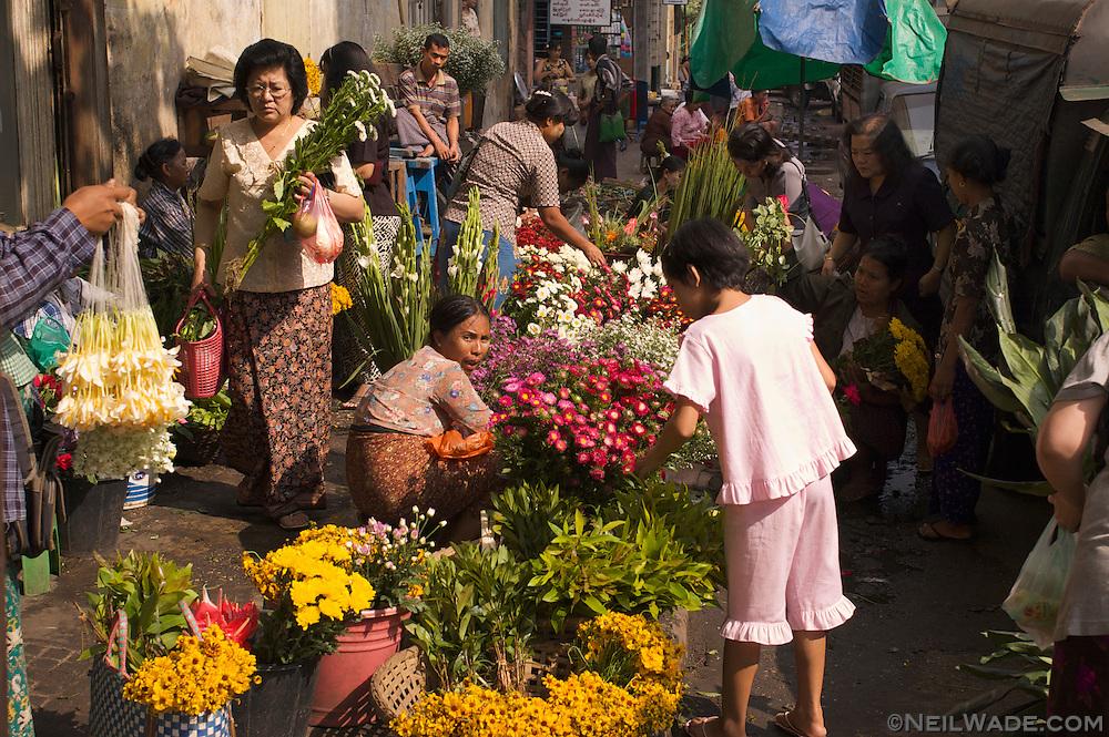 A busy street flower market in Yangon, Myanmar.