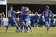 Man of the Match Dannie Bulman is surounded after putting his side 2-0 up during the Sky Bet League 2 match between AFC Wimbledon and Luton Town at the Cherry Red Records Stadium, Kingston, England on 21 February 2015. Photo by Stuart Butcher.