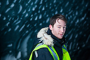 UNIS student Stephen Jennings stands in an ice cave on Rabotbreen, Svalbard.