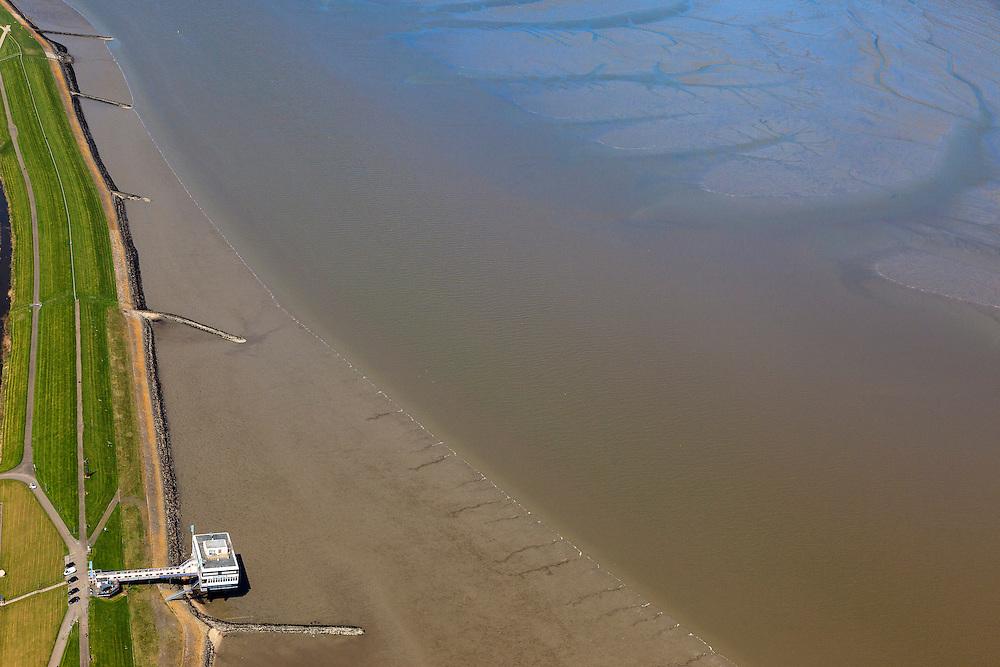 Nederland, Groningen, Delfzijl, 01-05-2013; Eemshotel. Het hotel is buitendijks gebouwd staat op palen in het water van de Eems.<br /> The Eemshotel, built outside the seawall on stilts in the water of the river Ems.<br /> luchtfoto (toeslag op standard tarieven);<br /> aerial photo (additional fee required);<br /> copyright foto/photo Siebe Swart