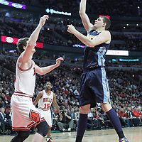 26 March 2012: Denver Nuggets center Timofey Mozgov (25) takes a jumpshot over Chicago Bulls center Omer Asik (3) during the Denver Nuggets 108-91 victory over the Chicago Bulls at the United Center, Chicago, Illinois, USA. NOTE TO USER: User expressly acknowledges and agrees that, by downloading and or using this photograph, User is consenting to the terms and conditions of the Getty Images License Agreement. Mandatory Credit: 2012 NBAE (Photo by Chris Elise/NBAE via Getty Images)