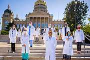 01 AUGUST 2020 - DES MOINES, IOWA: Medical doctors in front of the Iowa State Capitol Saturday. About 50 doctors, medical professionals, and public health professionals from across Iowa came to the State Capitol to demand that Iowa Governor Kim Reynolds impose a mask mandate to control the spread of the coronavirus (SARS-CoV-2). Despite the continued spread of the coronavirus and rapidly increasing infection rate for COVID-19, the Governor has refused to impose a mask mandate or close businesses. For the week ending Saturday, Aug. 1, Iowa reported new 2,736 new cases of COVID-19.             PHOTO BY JACK KURTZ