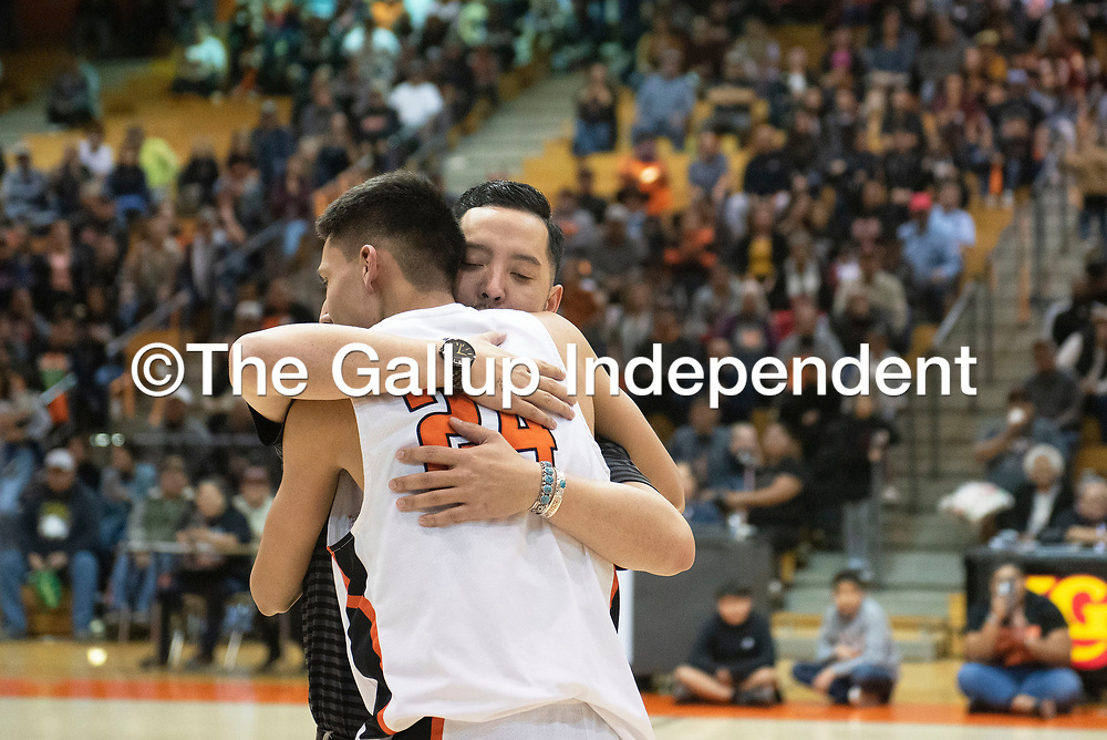 Gallup Bengals head coach Joshua Dunlap hugs Gallup Bengal Quinn Atazhoon as he is named district 1-4A tournament Most Valuable Player following their win in the championship game against Kirtland Central Broncos at Gallup High School Friday night in Gallup.
