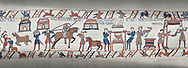 Bayeux Tapestry scene 41 - 42:  Cooks are supervised by Wadar, one of Williams servants. .<br /> <br /> If you prefer you can also buy from our ALAMY PHOTO LIBRARY  Collection visit : https://www.alamy.com/portfolio/paul-williams-funkystock/bayeux-tapestry-medieval-art.html  if you know the scene number you want enter BXY followed bt the scene no into the SEARCH WITHIN GALLERY box  i.e BYX 22 for scene 22)<br /> <br />  Visit our MEDIEVAL ART PHOTO COLLECTIONS for more   photos  to download or buy as prints https://funkystock.photoshelter.com/gallery-collection/Medieval-Middle-Ages-Art-Artefacts-Antiquities-Pictures-Images-of/C0000YpKXiAHnG2k